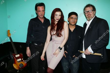 Stock Image of Christopher Smart, Chrysta Bell, Rodrigo Castro, and Pat Mastelotto stand backstage before she performs at Le Poisson Rouge in New York City on February 22, 2013.