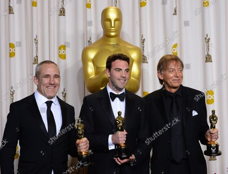 """Andy Nelson, Mark Paterson and Simon Hayes hold their Oscars for best Achievement in Sound Mixing - """" Les Miserables"""" backstage at the 85th Academy Awards at the Hollywood and Highland Center in the Hollywood section of Los Angeles on February 24, 2013."""