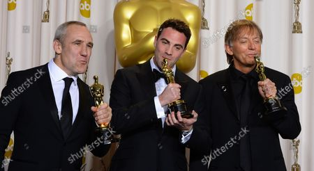 """Andy Nelson, Mark Paterson and Simon Hayes hold their Oscars for best Achievement in Sound Mixing - """"Les Miserables"""" backstage at the 85th Academy Awards at the Hollywood and Highland Center in the Hollywood section of Los Angeles on February 24, 2013."""