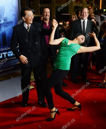 """Actor James Hong dances with his daughter April Hong during the premiere of the motion picture thriller """"Phantom"""", at TCL Chinese Theater in the Hollywood section of Los Angeles on February 27, 2013."""