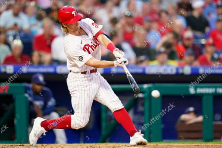 Philadelphia Phillies' Luke Williams hits a run-scoring double play during the second inning of an interleague baseball game against the Tampa Bay Rays, in Philadelphia