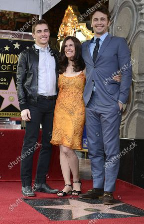 """Mother Betsy Franco (C) and brother Dave Franco (L) pose with James Franco during a ceremony where the actor receives a """"Star on the Hollywood Walk of Fame"""" in the Hollywood section of Los Angeles on March 7, 2013."""