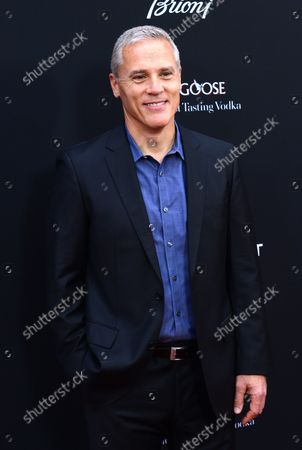 """Phil Austin attends the premiere of the picture thriller """"Olympus Has Fallen"""" at the ArcLight Cinerama Dome in the Hollywood section of Los Angeles on March 18, 2013.  In a national security thriller, Antoine Fuqua directs an all-star cast featuring Gerard Butler, Morgan Freeman, Angela Bassett, Melissa Leo, Ashley Judd and Rick Yune."""
