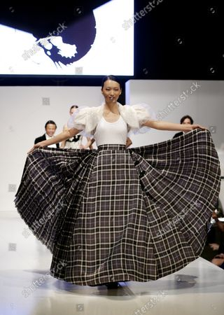 Stock Image of Ling Tan walks the runway at the 2013 From Scotland With Love Charity Fashion Show at Stage 48 in New York City on April 8, 2013.