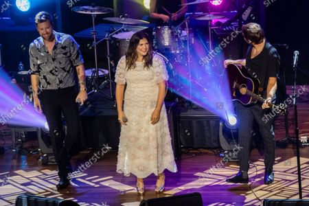 Charles Kelley, from left, Hillary Scott and Dave Haywood of Lady A perform at the 14th Annual ACM Honors at Ryman Auditorium, in Nashville, Tenn