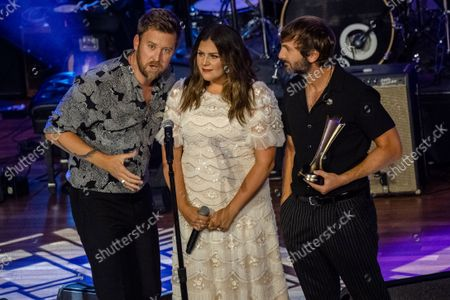 Charles Kelley, from left, Hillary Scott and Dave Haywood of Lady A accept the Gary Haber Lifting Lives Award at the 14th Annual ACM Honors at Ryman Auditorium, in Nashville, Tenn