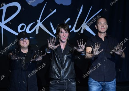 Members of the rock band Goo Goo Dolls, Robby Takac, John Rzeznik and Mike Malinin (L-R), participate in a ceremony inducting the group into Guitar CenterÕs RockWalk, in the Hollywood section of Los Angeles on May 7, 2013.