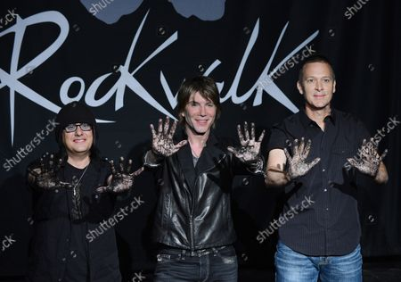 Members of the American rock band Goo Goo Dolls, Robby Takac, John Rzeznik and Mike Malinin (L-R), participate in a ceremony inducting the group into Guitar CenterÕs RockWalk, in the Hollywood section of Los Angeles on May 7, 2013.