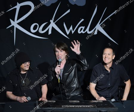 Stock Image of Members of the rock band Goo Goo Dolls, Robby Takac, John Rzeznik and Mike Malinin (L-R), participate in a ceremony inducting the group into Guitar CenterÕs RockWalk, in the Hollywood section of Los Angeles on May 7, 2013.