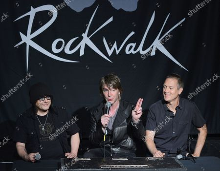 Stock Picture of Members of the rock band Goo Goo Dolls, Robby Takac, John Rzeznik and Mike Malinin (L-R), participate in a ceremony inducting the group into Guitar CenterÕs RockWalk, in the Hollywood section of Los Angeles on May 7, 2013.