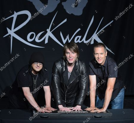 Stock Photo of Members of the rock band Goo Goo Dolls, Robby Takac, John Rzeznik and Mike Malinin (L-R), participate in a ceremony inducting the group into Guitar CenterÕs RockWalk, in the Hollywood section of Los Angeles on May 7, 2013.