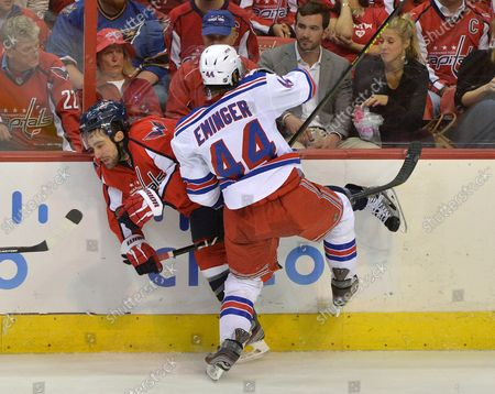 New York Rangers Steve Eminger hits Washington Capitals Jack Hillen during the second period of game 7 of the Eastern Conference Quarterfinals, at the Verizon Center on May 13, 2013 in Washington, D.C.