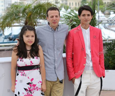 """Andrea Vergara (L), Amat Escalante (C) and Armando Espitia arrive at a photocall for the film """"Heli"""" during the 66th annual Cannes International Film Festival in Cannes, France on May 16, 2013."""