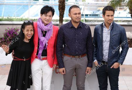 """Stock Image of (From R to L) Sam Milby, Adolfo Alix Jr., Jacky Woo and unidentified arrive at a photo call for the film """"Death March"""" during the 66th annual Cannes International Film Festival in Cannes, France on May 19, 2013."""