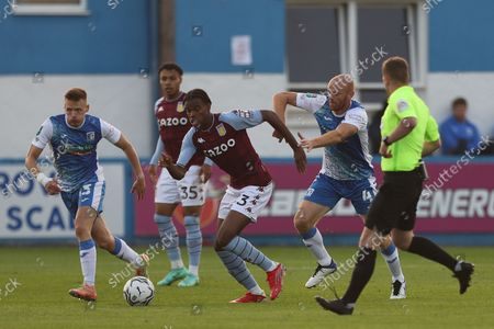 Aston Villa's Carney Chukwuemeka in action with Barrow's Jason Taylor   during the Carabao Cup 2nd round match between Barrow and Aston Villa at Holker Street, Barrow-in-Furness on Tuesday 24th August 2021.