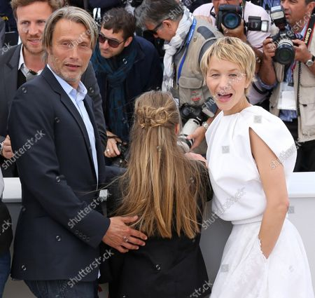 """Stock Image of Mads Mikkelsen (L), Melusine Mayance (C) and Delphine Chuillot arrive at a photo call for the film """"Michael Kohlhass"""" during the 66th annual Cannes International Film Festival in Cannes, France on May 24, 2013."""