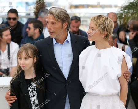 """Stock Photo of Melusine Mayance (L), Mads Mikkelsen (C) and Delphine Chuillot arrive at a photo call for the film """"Michael Kohlhass"""" during the 66th annual Cannes International Film Festival in Cannes, France on May 24, 2013."""
