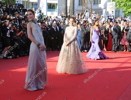 """Stock Photo of Cansu Dere (L), Saadet Aksoy (C) and Ximena Navarrete arrive on the red carpet before the screening of the film """"La Venus a la fourrure (Venus In Fur)"""" during the 66th annual Cannes International Film Festival in Cannes, France on May 25, 2013."""