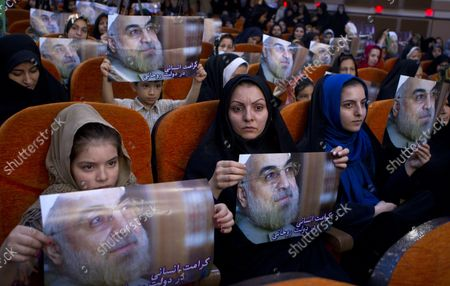 Stock Photo of Supporters of moderate presidential candidate and former top nuclear negotiator Hassan Rohani attend his presidential campaign rally in Tehran, Iran on May 30, 2013.  The United States has questioned the credibility of Iran's June 14th election due to the disqualification of former president Akbar Hashemi Rafsanjani and reform candidates Mir Hossein Mousavi and Mehdi Karroubi, who remain under house arrest following the elections in 2009.