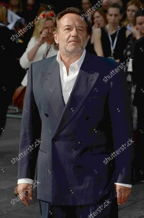 """Dutch film producer, director and actor Ludi Boeken attends the world premiere of """"World War Z"""" at The Empire Leicester Square in London on June 2, 2013."""