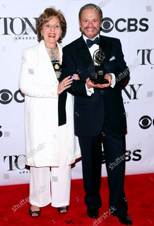 Producers Fran Weissler and Barry Weissler, winners of the Tony Award for Best Revival of a Musical for 'Pippin,' arrive in the pressroom at the 67th Annual Tony Awards held at Radio City Music Hall on June 9, 2013 in New York City.