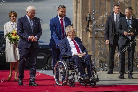German President Frank-Walter Steinmeier (2-L) and his wife Elke Buedenbender (L) are welcomed by Czech President Milos Zeman (R) at Prague Castle in Prague, Czech Republic, 26 August 2021.