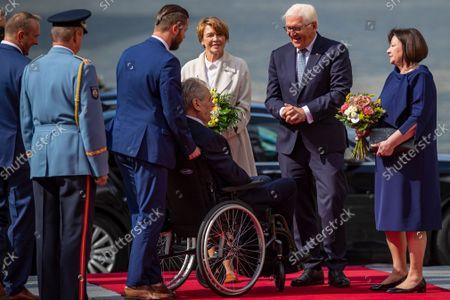 German President Frank-Walter Steinmeier (2-R) and his wife Elke Buedenbender (C) are welcomed by Czech President Milos Zeman (wheelchair) and his wife Ivana Zemanova (R) at Prague Castle in Prague, Czech Republic, 26 August 2021.
