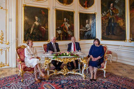 Stock Image of German President Frank-Walter Steinmeier (2-L), his wife Elke Buedenbender (L), Czech President Milos Zeman (2-R) and his wife Ivana Zemanova (R) pose for photographers at Prague Castle in Prague, Czech Republic, 26 August 2021.