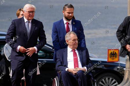 Czech Republic's President Milos Zeman, in wheelchair right, welcomes his German counterpart Frank-Walter Steinmeier, left, at the Prague Castle in Prague, Czech Republic