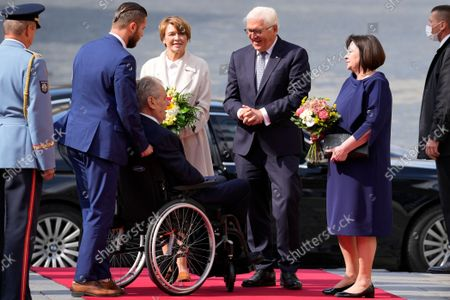 Stock Photo of Czech Republic's President Milos Zeman, center, with his wife Ivana, right, welcomes his German counterpart Frank-Walter Steinmeier, 2nd right, accompanied with his wife Elke Buedenbender, at the Prague Castle in Prague, Czech Republic