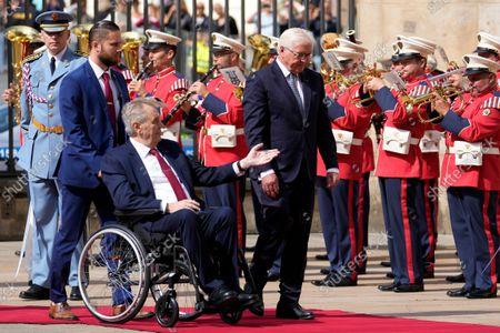 Czech Republic's President Milos Zeman, in wheelchair, welcomes his German counterpart Frank-Walter Steinmeier, right, at the Prague Castle in Prague, Czech Republic