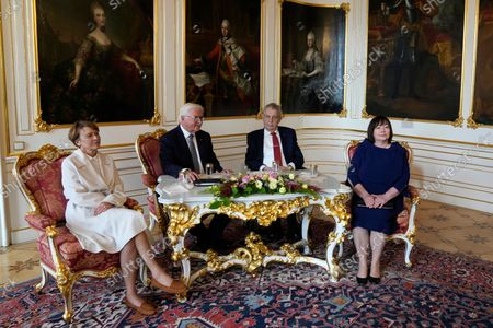 Czech Republic's President Milos Zeman, 2nd right, with his wife Ivana, right, welcomes his German counterpart Frank-Walter Steinmeier, 2nd left, accompanied with his wife Elke Buedenbender at the Prague Castle in Prague, Czech Republic