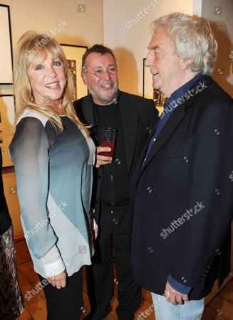 Patti Boyd, guest and Frank Lowe