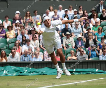 Argentine Juan Martin Del Potro returns in his match against Canadian Jesse Levine on day four of the 2013 Wimbledon Championships in London on June 27, 2013.