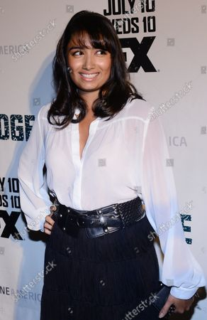 """Actress Natalie Amenula, a cast member in the FX television series """"The Bridge'"""", attends the show's premiere at the DGA Theatre in Los Angeles on July 8, 2013."""