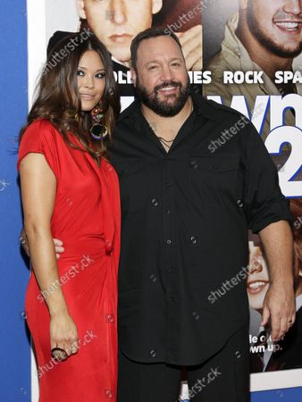 Steffiana De La Cruz and Kevin James arrive on the red carpet at a special New York screening of 'Grown Ups 2' at AMC Loews Lincoln Square in New York City on July 10, 2013.