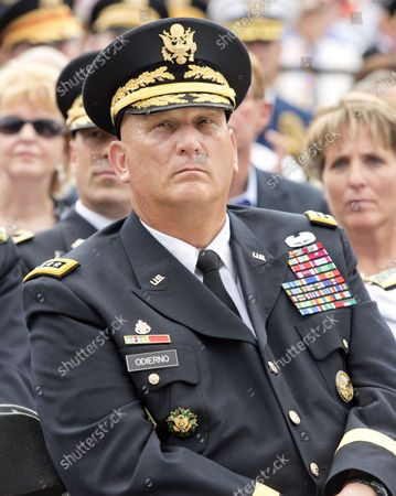 """United States Army General Raymond T. """"Ray"""" Odierno, Chief of Staff of the Army, listens as United States President Barack Obama delivers remarks marking the 60th Anniversary of the Korean War Armistice at the Korean War Veterans Memorial in Washington, D.C. on Saturday, July 27, 2013."""