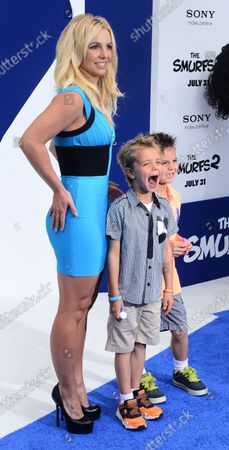"""Singer Britney Spears, who performs """"Ooh La La"""" in the motion picture animated comedy """"The Smurfs 2"""", attends the premiere of the film with sons Sean Federline (L) and Jayden James Federline at the Regency Village Theatre, in the Westwood section of Los Angeles on July 28, 2013. The Smurfs join forces with their human friends to rescue Smurfette, who has been kidnapped by Gargamel since she knows a secret spell that can turn the evil sorcerer's newest creation - creatures called the Naughties - into real Smurfs."""