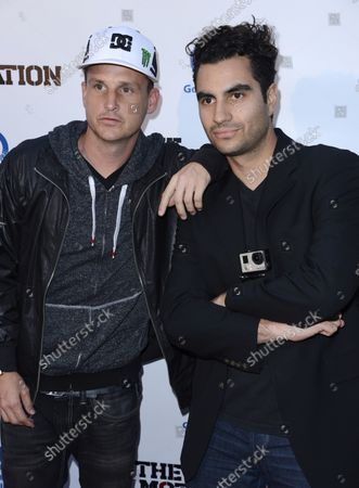 """Cast member Rob Dyrdek (L) and director Adam Bhala Lough attend the premiere of the film """"The Motivation"""" at the Arclight Theatre in the Hollywood section of Los Angeles on July 30, 2013."""