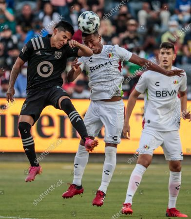 Los Angeles, CA, Wednesday, August 25, 2021 - Liga MX midfielder Pedro Aquino, right, and MLS forward Raul Ruidiaz compete for the ball in the first half of the MLS All-Star game at Banc of California Park. (Robert Gauthier/Los Angeles Times)