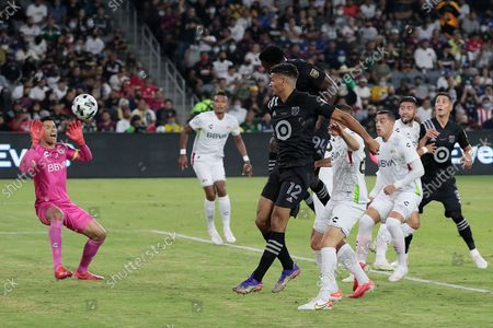 Los Angeles, CA, Wednesday, August 25, 2021 - Jesus Murillo, behind Miles Robinson, 12, scores on a header past Liga MX goalie Alfredo Talavera, left, during second half action at the MLS All-Star game at Banc of California Park. (Robert Gauthier/Los Angeles Times)