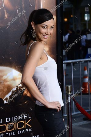 """Actress Mei Melancon attends the premiere of the sci-fi motion picture thriller """"Riddick"""" at the Regency Village Theatre in the Westwood section of in Los Angeles on August 28, 2013.  Left for dead on a sun-scorched planet, Riddick fights for survival against alien predators. Riddick, seeking to escape the planet activates an emergency beacon alerting two ships: one carrying a new breed of mercenary, the other captained by a man from Riddick's past."""