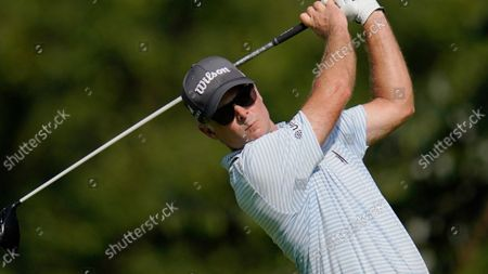 Stock Photo of Kevin Streelman tees off on the second hole during the first round of the BMW Championship golf tournament, at Caves Valley Golf Club in Owings Mills, Md
