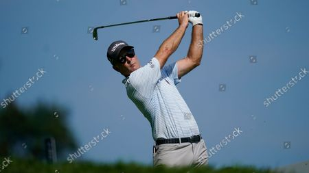 Stock Picture of Kevin Streelman tees off on the third hole during the first round of the BMW Championship golf tournament, at Caves Valley Golf Club in Owings Mills, Md