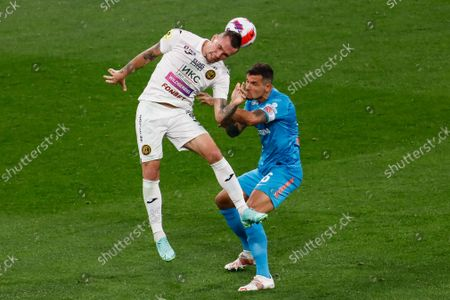 Stock Photo of Dejan Lovren (R) of Zenit and Anton Zabolotny of CSKA Moscow vie for the ball during the Russian Premier League match between FC Zenit Saint Petersburg and PFC CSKA Moscow on August 26, 2021 at Gazprom Arena in Saint Petersburg, Russia.
