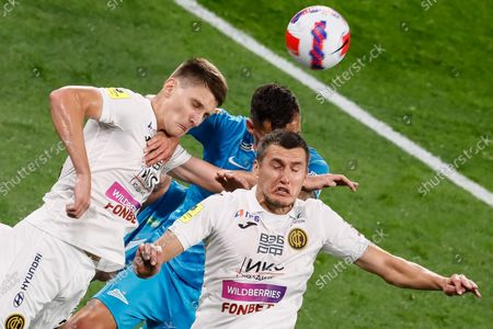 Dejan Lovren of Zenit vies for a header with Igor Diveev (L) and Viktor Vasin (R) of CSKA Moscow during the Russian Premier League match between FC Zenit Saint Petersburg and PFC CSKA Moscow on August 26, 2021 at Gazprom Arena in Saint Petersburg, Russia.