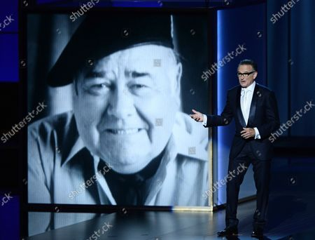 Stock Photo of Comedian and actor Robin Williams delivers a memorial presentation for Jonathan Winters at the 65th annual Primetime Emmy Awards at Nokia Theatre in Los Angeles on September 22, 2013.