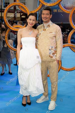 Director Destin Daniel Cretton, right and actor Fala Chen pose for photographs on the red carpet for the premiere of Shang-Chi, at a cinema in west London