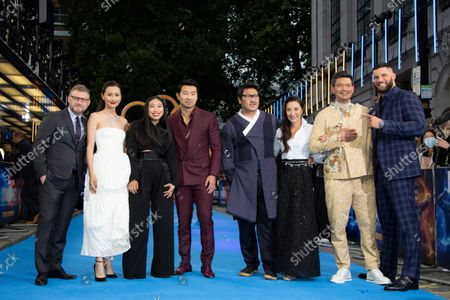 From left to right producer Jonathan Schwartz, actors Fala Chen, Awkwafina, Simu Liu, Benedict Wong, Michelle Yeoh, Director Destin Daniel Cretton and Fiorian Munteanu pose for photographs on the red carpet for the premiere of Shang-Chi, at a cinema in west London