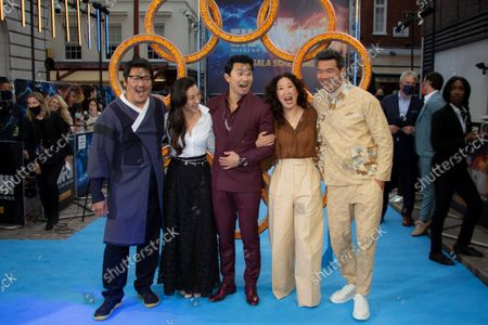 Actors from left to right Benedict Wong, Michelle Yeoh, Simu Liu, Sandra Oh and Director Destin Daniel Cretton, pose for photographs on the red carpet for the premiere of Shang-Chi, at a cinema in west London